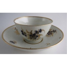 Worcester Tea Bowl and Saucer, Decorated in Underglaze Blue with Formal Flowers, Honey Gold Leaves and Stems, Gold Dentil Rim and Base, c1785